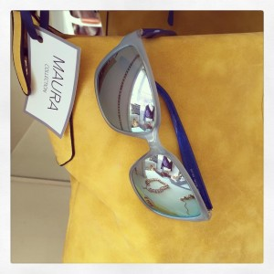 Salvatore Ferragamo frame with a electric blue mirrored lens and yellow bag